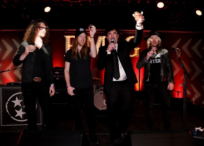 Kelby Ray and Neil Mason of The Cadillac Three, Scott Borchetta, and Jaren Johnston of The Cadillac Three toast on-stage at the BMLG After-Party on November 5, 2014 in Nashville, Tennessee. (Photo by Ilya S. Savenok/Getty Images for Crown Royal)