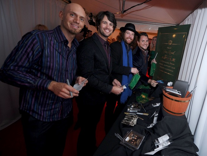 Brian Kelley and Tyler Hubbard of Florida Georgia Line take a moment to pack a Crown Royal Regal Apple care package in effort to honor US troops overseas at the BLMG After Party on November 5, 2014 in Nashville, Tennessee. (Photo by Ilya S. Savenok/Getty Images for Crown Royal)