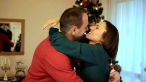 stock-footage-couple-talking-in-front-of-christmas-tree