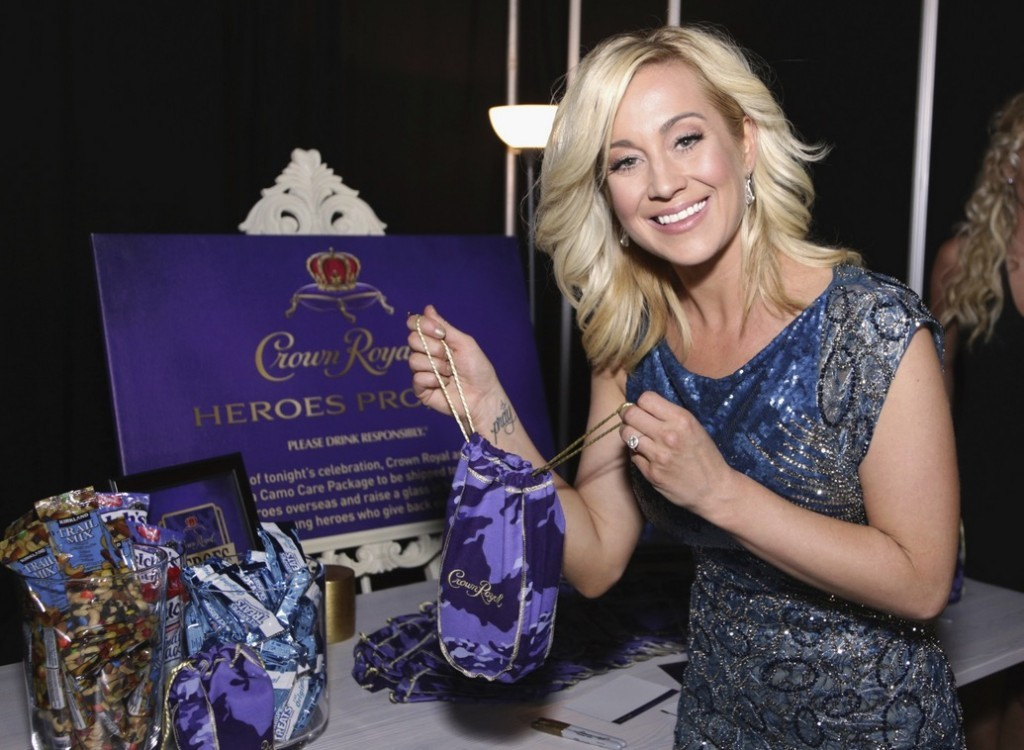 Musician Kellie Pickler stuffs a Crown Royal CAMO care package to be sent to troops backstage at the 2015 CMT Awards at Bridgestone Arena on June 10, 2015 in Nashville, Tennessee. (Photo by Anna Webber/Getty Images for Crown Royal)